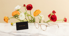 We're celebrating Mother's Day in advance with a $20 discount on eyewear!
